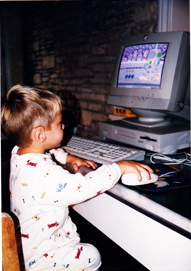 Cooper, as a kid, on the computer.